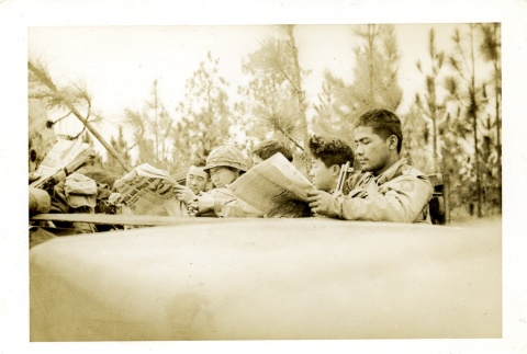 Soldiers reading newspapers (ddr-densho-22-208)