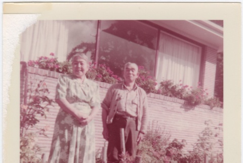 Man and woman standing in garden in front of house (ddr-densho-332-22)