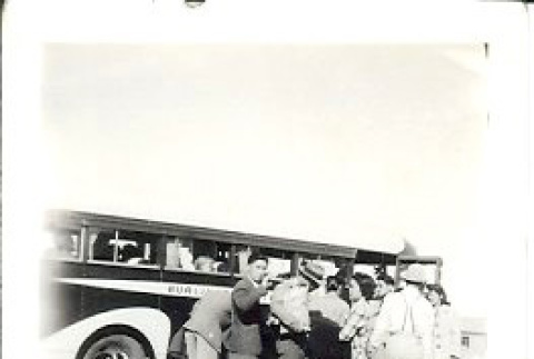 Boarding a bus to leave camp (ddr-densho-339-1)