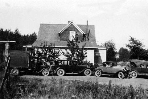 Cars in front of Green Lake house (ddr-densho-134-3)