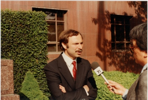 Interview outside of the courthouse  during Gordon Hirabayashi's hearing (ddr-densho-10-71)