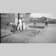 High school students cleaning up for gardens (ddr-fom-1-728)