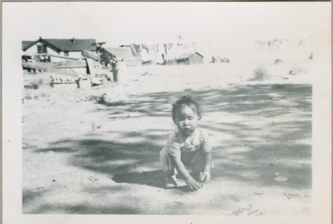 A toddler playing outside (ddr-densho-300-66)