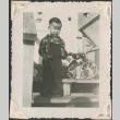 Toddler with a tricycle on porch steps (ddr-densho-321-240)