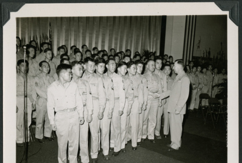 Officer shakes hand with service men (ddr-densho-397-24)