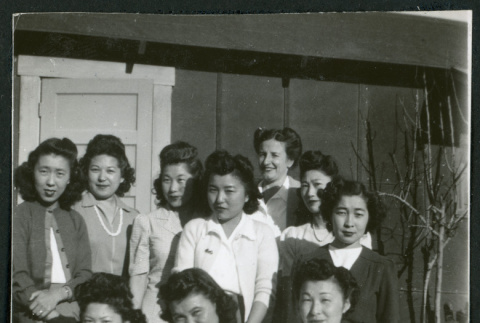 Photograph of hospital staff posing in front of the Manzanar hospital (ddr-csujad-47-255)