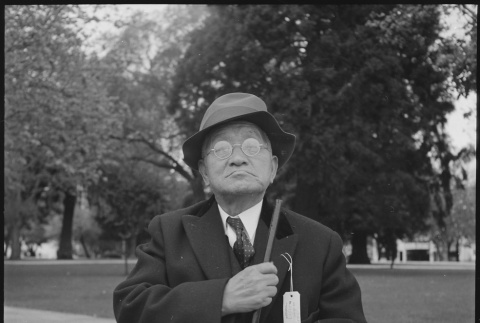 Grandfather waiting for bus (ddr-densho-151-46)