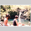 Tomi Iino and young woman looking at waterfall (ddr-densho-368-313)