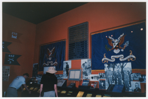 photograph and flag in 442nd RCT exhibit at Smithsonian (ddr-densho-368-260)