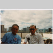 Two men on outdoor patio (ddr-densho-368-401)