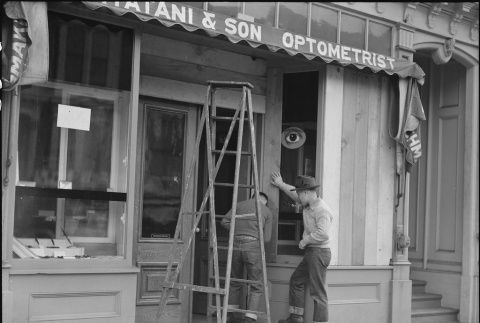 Japanese Americans boarding up their store (ddr-densho-151-234)
