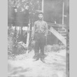 [Man in front of building] (ddr-csujad-56-301)