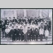 Group of boys and girls standing on steps of building (Maryknoll school) (ddr-densho-330-217)