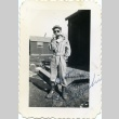 Soldier playing a harmonica (ddr-densho-22-409)