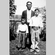 Three brothers standing in a garden (ddr-densho-18-1)