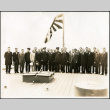 Seiso Bitow and others stand on the deck of a Japanese naval ship (ddr-densho-395-85)