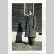 Soldier in front of a building (ddr-densho-22-165)