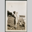 Woman and baby on beach (ddr-densho-359-697)