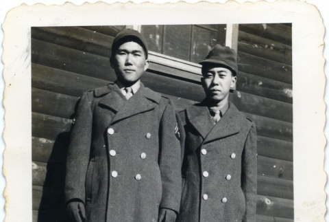 Two soldiers in front of a building (ddr-densho-22-169)