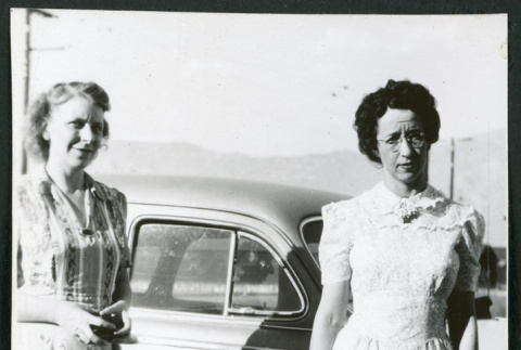 Photograph of women standing in front of a car (ddr-csujad-47-323)