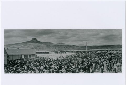 Crowd at Heart Mountain, Wyoming concentration camp awaiting transfer to Tule Lake California September 27, 1943 (ddr-densho-122-722)