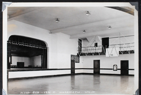 Auditorium with a stage and basketball court (ddr-densho-404-182)