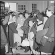 Japanese American family waiting for the bus (ddr-densho-151-107)