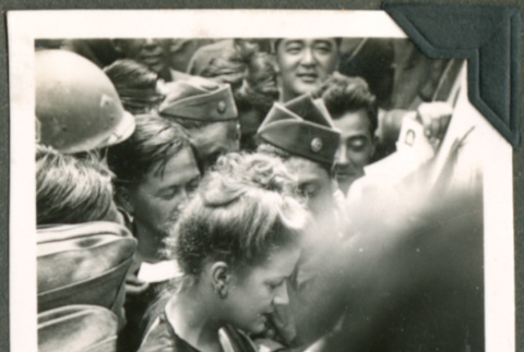 Soldiers getting an autograph (ddr-densho-201-557)