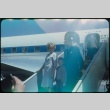 A man, woman, and child deboarding a plane (ddr-densho-338-515)