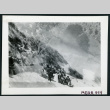 Photograph of a group of people holding snow balls on the side of a mountain with a snowman (ddr-csujad-47-295)
