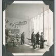 Visitors looking at the Brazil exhibition room at the Golden Gate International Exposition (ddr-densho-300-190)