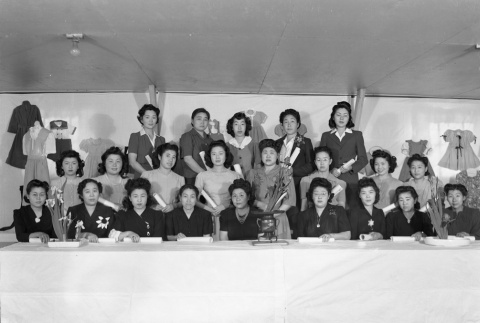 Group photo at a sewing exhibit in camp (ddr-fom-1-683)