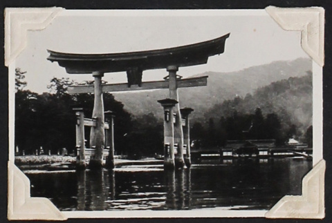 Torii gate rising from the water (ddr-densho-404-155)