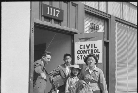 Japanese American family with baggage (ddr-densho-151-245)