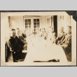 Group of men around a dining table (ddr-densho-259-25)