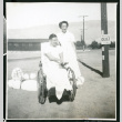 Photograph of Peter Hondo in a wheelchair with Thelma McBride at Manzanar (ddr-csujad-47-250)