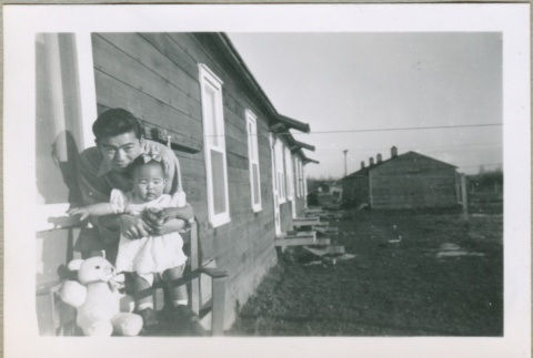A baby with her uncle (ddr-densho-300-51)