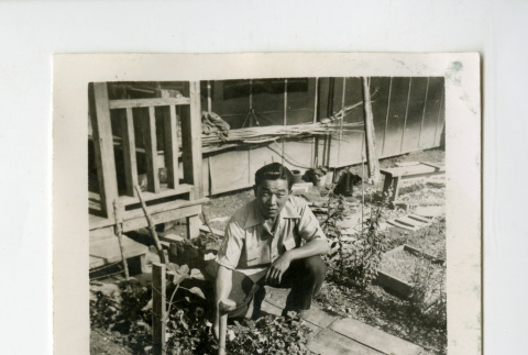 Man in victory garden at the Jerome camp (ddr-csujad-38-100)