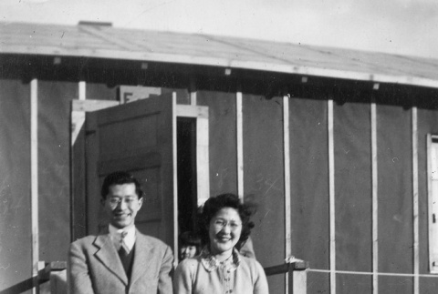 Minister and wife in front of barracks (ddr-densho-152-26)