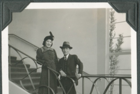 A man and woman standing on a staircase at the Golden Gate International Exposition (ddr-densho-300-219)