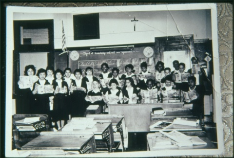 Boys and girls at front of classroom reading (Maryknoll school) (ddr-densho-330-167)