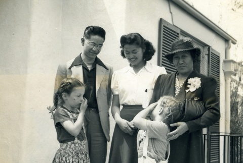 Clarence Matsumura with his family and friends (ddr-densho-22-102)