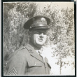 Photograph of a army soldier standing in front of trees (ddr-csujad-47-115)
