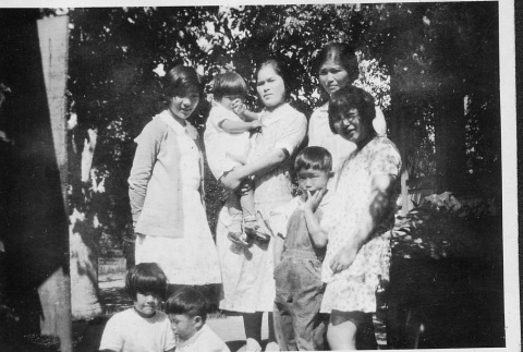 [Mrs. Taniguchi and family in orchard] (ddr-csujad-56-280)