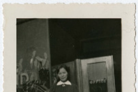 Masa Kosai standing in front of the Grand Hotel (ddr-densho-349-4)