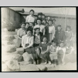 Photograph of a group of women and girls posing on the rocks next to the Manzanar hospital (ddr-csujad-47-211)