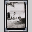 Two men pose in the shade (ddr-densho-404-208)