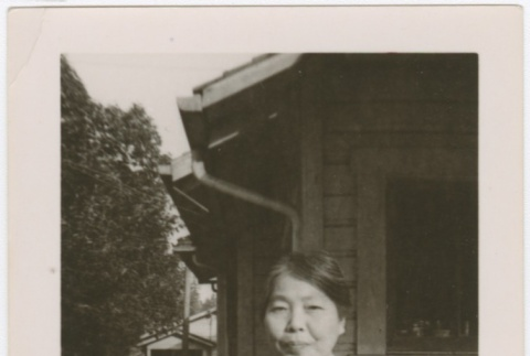 Woman standing in front of house (ddr-densho-332-24)