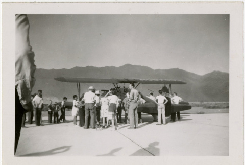 People with plane at Manzanar airport (ddr-manz-8-6)