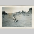 A toddler playing outside (ddr-densho-300-65)